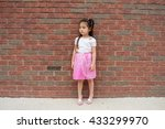 a cute little girl wearing pink ... | Shutterstock . vector #433299970