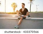 A Skateboarder Wearing Black T...