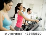 young woman training on a cross ... | Shutterstock . vector #433450810