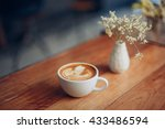 cup of coffee latte art on the...
