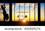 Small photo of Young woman silhouette at Airport with suitcase. Private jet plane on background. Travel concept of air transportation