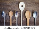 one spoon with smiley face... | Shutterstock . vector #433604179