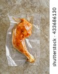 Small photo of Chicken leg sealed in an airtight plastic bag ready for sous vide cooking