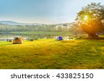 Camping And Tent Near Lake In...