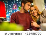 romantic couple in city at night   Shutterstock . vector #433955770