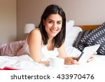 young woman relaxing with her... | Shutterstock . vector #433970476