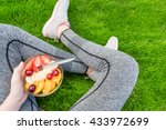 young girl eating a fruit salad ... | Shutterstock . vector #433972699