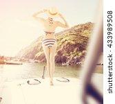 boat woman in blue bikini and... | Shutterstock . vector #433989508