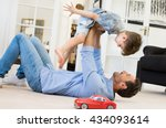 happy father playing with son... | Shutterstock . vector #434093614