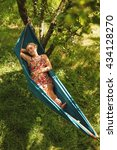 woman laying in hammock and... | Shutterstock . vector #434128270
