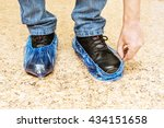 blue medical shoe covers are... | Shutterstock . vector #434151658