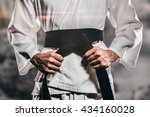 fighter tightening karate belt... | Shutterstock . vector #434160028