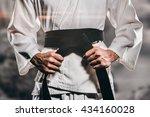 fighter tightening karate belt... | Shutterstock . vector #434160028