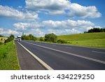 Asphalt Road With Trucks...