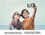 two young women friends taking... | Shutterstock . vector #434282584