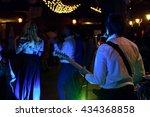 Stylish Guitarist Singing On A...