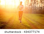 fitness woman running on the... | Shutterstock . vector #434377174