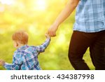 child  baby holding an adult's... | Shutterstock . vector #434387998