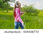 girl with phone and headphones | Shutterstock . vector #434438773