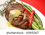 Filet mignon with bearnaise sauce, green beans, red bell pepper, sesame seeds and rosemary. - stock photo