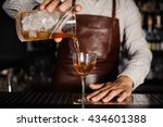 barman pouring alcoholic... | Shutterstock . vector #434601388