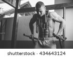 man in a gym with equipments | Shutterstock . vector #434643124