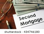 Small photo of Paper with words second mortgage.