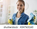 Woman Cleaning Window With...