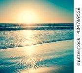 Sunset Over The Ocean. Sand...