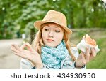 young woman eating fast food... | Shutterstock . vector #434930950