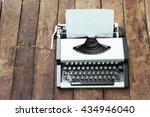 typewriter on old wooden... | Shutterstock . vector #434946040