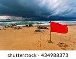 Red Warning Flag At Beach....