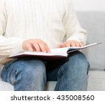 blind man reading braille book... | Shutterstock . vector #435008560