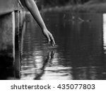 a hand reaching to water... | Shutterstock . vector #435077803
