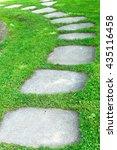 cement footpath in green grass | Shutterstock . vector #435116458