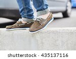 young man legs and brown... | Shutterstock . vector #435137116