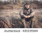 Hunter Man In Rural Field With...