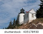 Small photo of Bass Harbor lighthouse sits atop a rocky cliff in Acadia, maine.