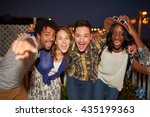 Stock photo multi ethnic millenial group of friends taking a flash selfie photo with mobile phone on rooftop 435199363