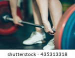 female on weightlifting training | Shutterstock . vector #435313318