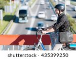 Commuter Riding E Bike ...