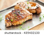 pork chop with thyme on tray | Shutterstock . vector #435432133