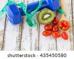 fresh kiwi dumbbell and red... | Shutterstock . vector #435450580