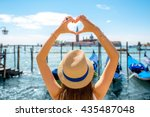 woman making heart shape with... | Shutterstock . vector #435487048