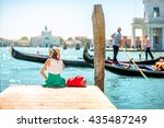 young female traveler sitting... | Shutterstock . vector #435487249