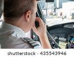Pilot In An Aircraft Cockpit...