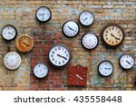 old clocks on the brick wall  ...