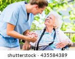 nurse holding hand of senior... | Shutterstock . vector #435584389
