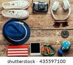 set of trip stuff on wooden... | Shutterstock . vector #435597100