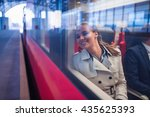 smiling woman in a train | Shutterstock . vector #435625393